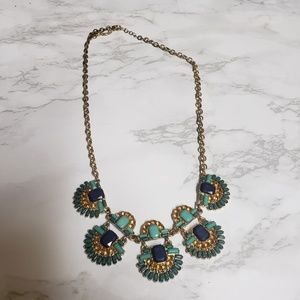 Francesca's gold necklace with turquoise